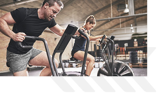 Man and woman on cardio machines