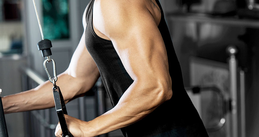 Man doing single-armed cable tricep extensions