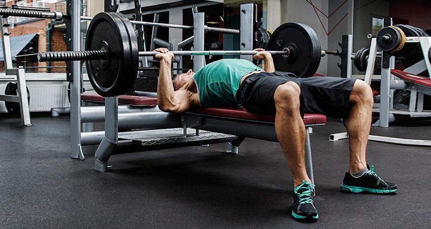 Man bench pressing 225 pounds