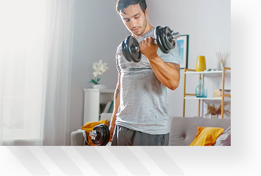 Man doing bicep curls with dumbbells at home