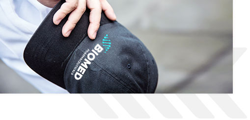 Hand holding Biomed hat