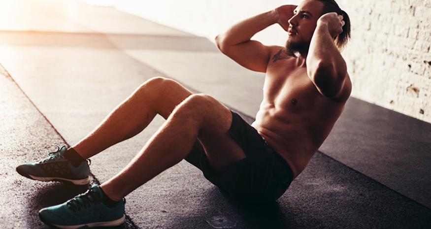 Man doing situps on gym floor